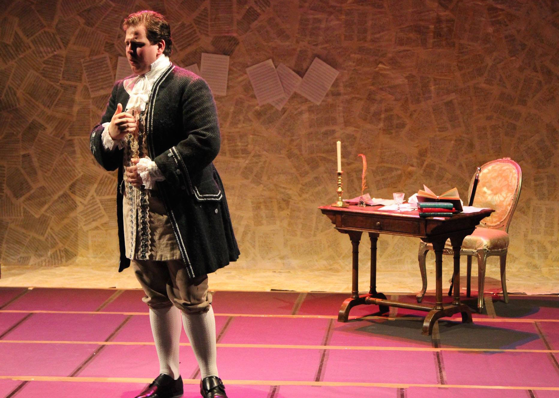 Colour photograph of Jonathan Forbes Kennedy, baritone, on stage in costume as 'The Poet' during a Royal Conservatoire of Scotland production of the Salieri's Prima la musica e poi la parole (photo credit: Royal Conservatoire of Scotland)