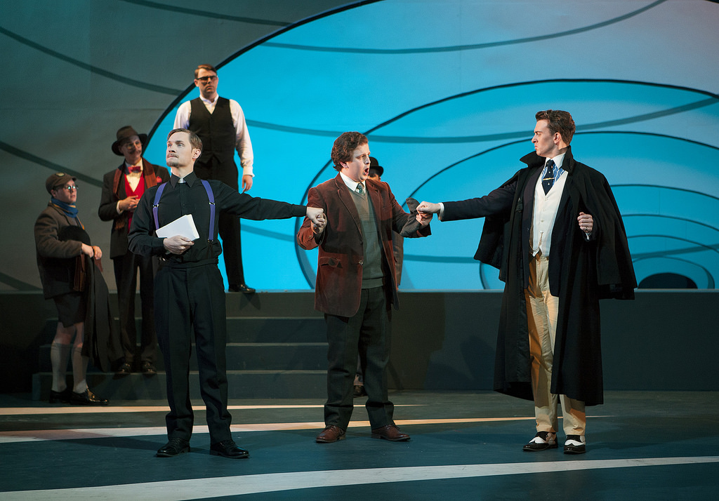 Colour photograph showing Jonathan and fell cast members on stage during a scene from a production at the Royal Conservatoire of Scotland of Vaughan-Williams' Sir John in love