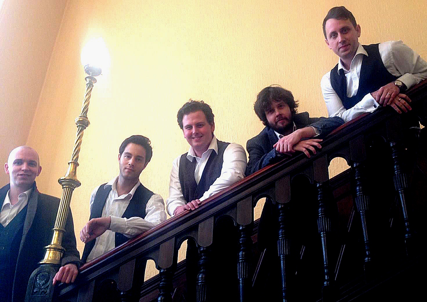 Colour portrait photograph showing Jonathan Forbes Kennedy, baritone, with fellow members of Scozzesi, the male vocal ensemble (Courtesy of Classical Musicians Scotland)