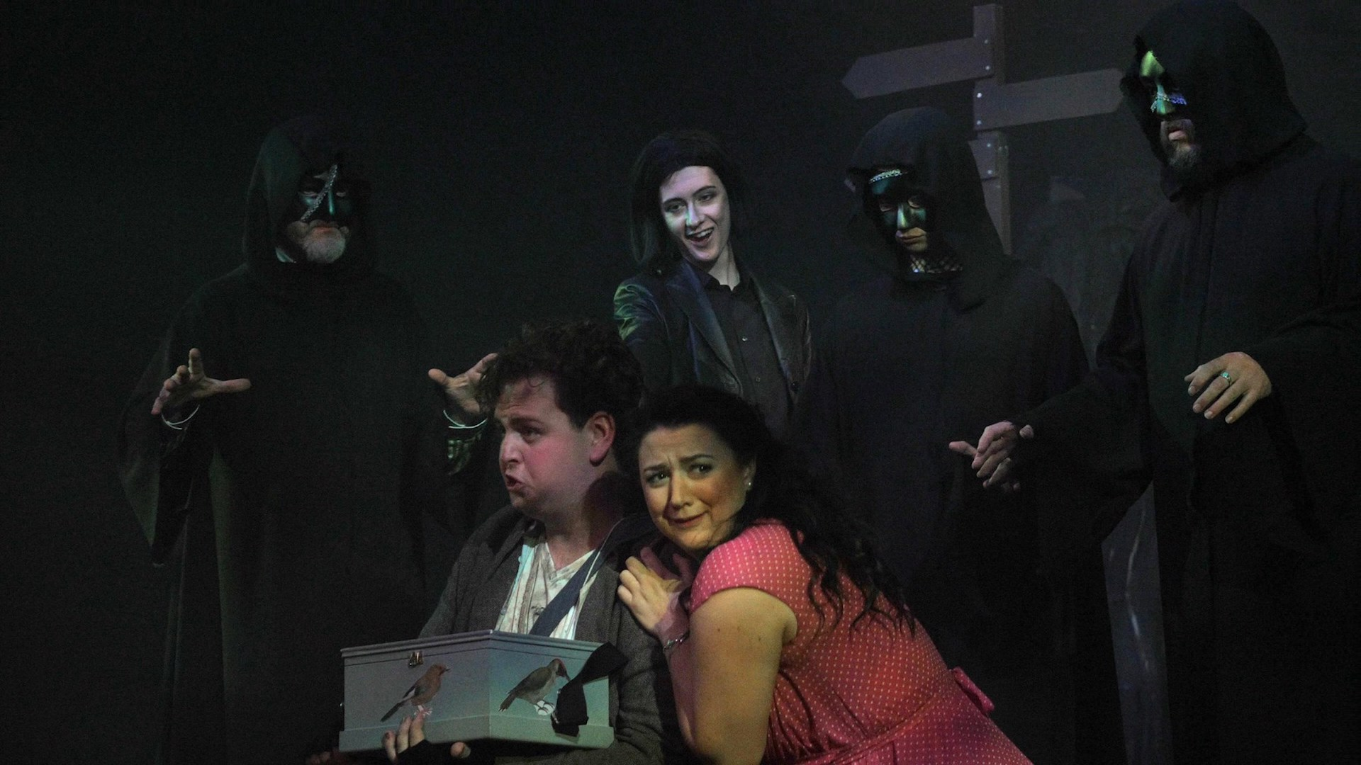 Colour photograph showing Jonathan Forbes Kennedy, baritone, on stage with fellow cast members in the role of Papageno in Fife Opera's 2017 production of Mozart's The Magic Flute (Courtesy of Douglas Taylor for Fife Opera)