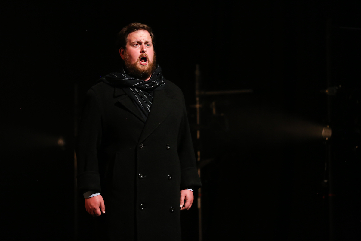 Colour photograph of Jonathan Forbes Kennedy, baritone, in a scene from Eugene Onegin by Tchaikovsky, RCS Opera Scenes (photo credit: Royal Conservatoire of Scotland)