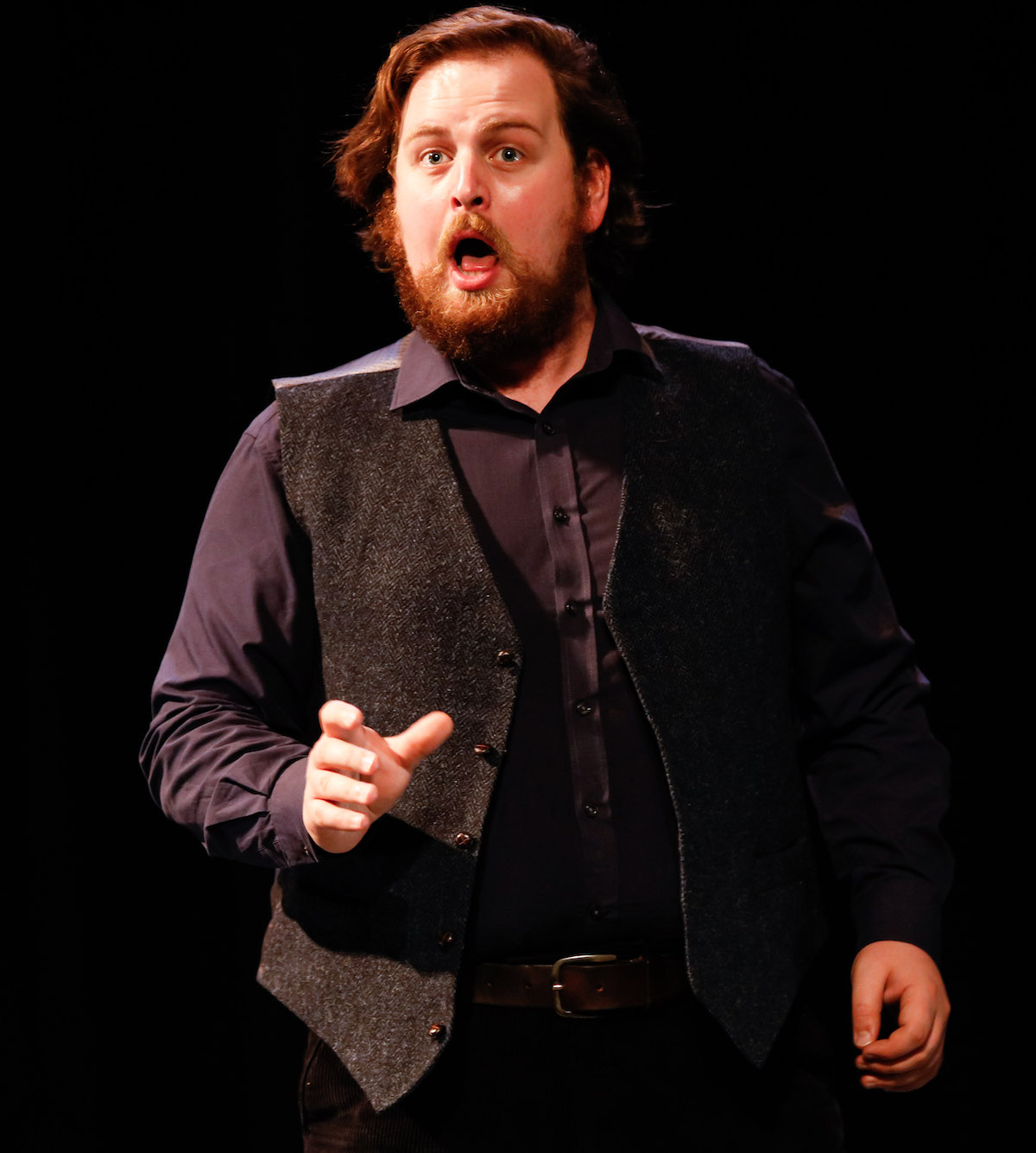 Colour photograph of Jonathan Forbes Kennedy, baritone, on stage as Sid in Britten's Albert Herring, 2021. RCS Opera Scenes (photo credit: Royal Conservatoire of Scotland)